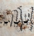 Petroglyph with flute player evoking big horned sheep, abundant plants, and hunting success